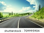 road in north mountain forest | Shutterstock . vector #709995904