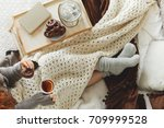 young woman spending a cold... | Shutterstock . vector #709999528