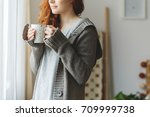 young woman with mug standing... | Shutterstock . vector #709999738
