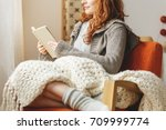 happy young woman reading a... | Shutterstock . vector #709999774