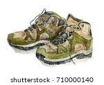 a pair of hiking boots isolated ... | Shutterstock . vector #710000140
