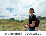 young hipster man meditates... | Shutterstock . vector #710010820