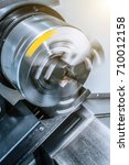 Small photo of Rotating chuck of CNC lathe. Abstract industrial background.