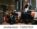 band of adult guitarists... | Shutterstock . vector #710017024