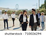 happy man and woman on business ... | Shutterstock . vector #710026294