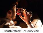 close up shot of man tasting... | Shutterstock . vector #710027920