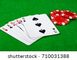 Poker hand showing two pair with betting chips - stock photo