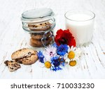 milk and cookies on a old... | Shutterstock . vector #710033230