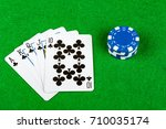 Poker hand Royal Flush Clubs With Betting Chips - stock photo