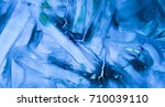 bright blue daub with cracks on ... | Shutterstock . vector #710039110