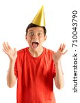 Young teenage boy isolated on white looking surprised at a party - stock photo