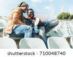 two black race friends having... | Shutterstock . vector #710048740