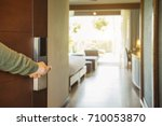 Stock photo close up of male hand opening hotel room 710053870