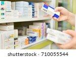 pharmacist holding medicine box ...   Shutterstock . vector #710055544