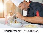 chef in private kitchen...   Shutterstock . vector #710080864