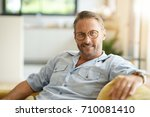 handsome mature man with... | Shutterstock . vector #710081410