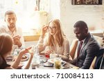 business colleagues eating meal ... | Shutterstock . vector #710084113