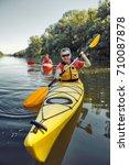 man paddling in a kayak on...   Shutterstock . vector #710087878