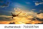 silhouette from a landing plane ... | Shutterstock . vector #710105764