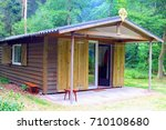 Wooden bungalow with kitchen, bedroom, bathroom and outdoor patio in forest garden, tourist accommodation in Holland