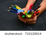 colorful pencils in hand student | Shutterstock . vector #710120014