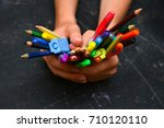 girl holding many colorful... | Shutterstock . vector #710120110
