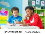 two boy kid sit on table and... | Shutterstock . vector #710130328