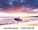 surfer holding a sup paddle... | Shutterstock . vector #710132578