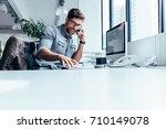 businessman sitting in office... | Shutterstock . vector #710149078