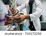 doctor hand finding a medicine... | Shutterstock . vector #710172250