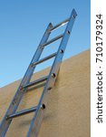 Small photo of Ladder to the flat roof of an adobe building
