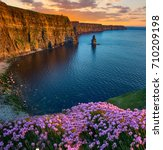 Small photo of beatiful sunset from the cliffs of moher in county clare, ireland. the cliffs of moher is one of irelands top tourism attractions aloing the wild atlantic way