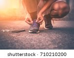 young man running with smart... | Shutterstock . vector #710210200