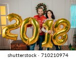 happy young couple with new... | Shutterstock . vector #710210974