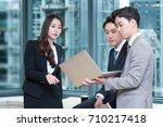 three businessman talking about ... | Shutterstock . vector #710217418