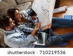 young couple examining... | Shutterstock . vector #710219536
