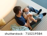 modern father playing with... | Shutterstock . vector #710219584