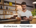 waiter using digital tablet... | Shutterstock . vector #710224810
