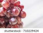 bunches of fresh ripe red... | Shutterstock . vector #710229424