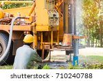 ground water hole drilling... | Shutterstock . vector #710240788