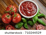 tomatoes  ketchup and basil on... | Shutterstock . vector #710244529