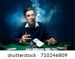 man is playing poker. with a... | Shutterstock . vector #710246809