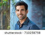 handsome mid adult man smiling... | Shutterstock . vector #710258758