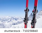 pair of red skis standing in... | Shutterstock . vector #710258860