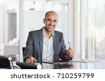 happy mature business man... | Shutterstock . vector #710259799