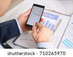 smartphone calculator and... | Shutterstock . vector #710265970
