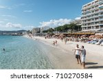 Small photo of Juan les Pins, France - September 1st, 2017: Busy beach in Juan les Pins, Cote d'Azur, France. The city is famous for its annal Jazz Festival