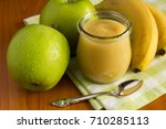 puree with apples and banana on ... | Shutterstock . vector #710285113