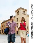couple holding hands in old... | Shutterstock . vector #710299690