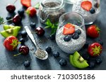 chia pudding with berries ... | Shutterstock . vector #710305186